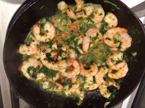 Prawns frying with garlic and chilli