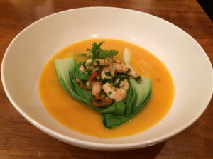 Pumpkin and coconut broth with spicy prawns