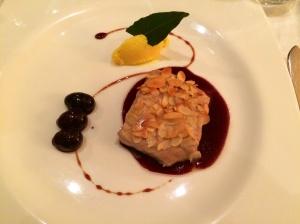 Sturgeon with black grape sauce